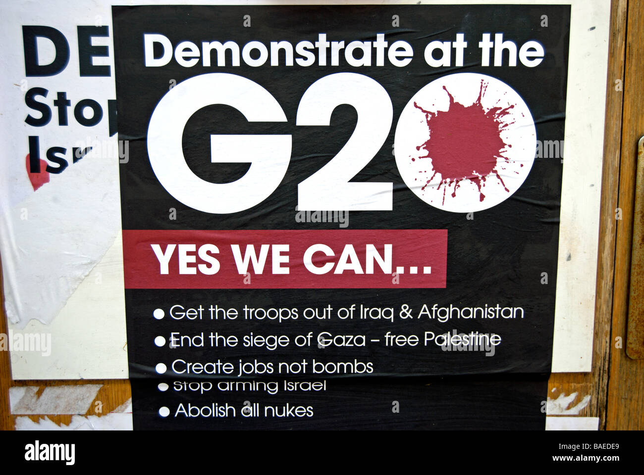 poster for g20 antiwar demonstration at the american embassy, london, april 2009, on a wall in hounslow, west london, - Stock Image