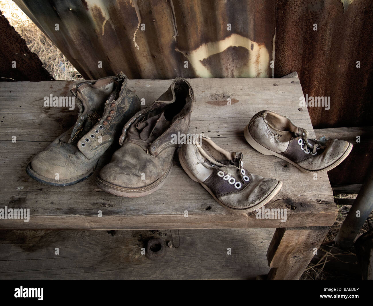 Old shoes on a bench - Stock Image