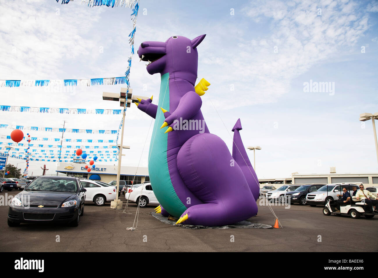 inflatable purple and green dragon - Stock Image