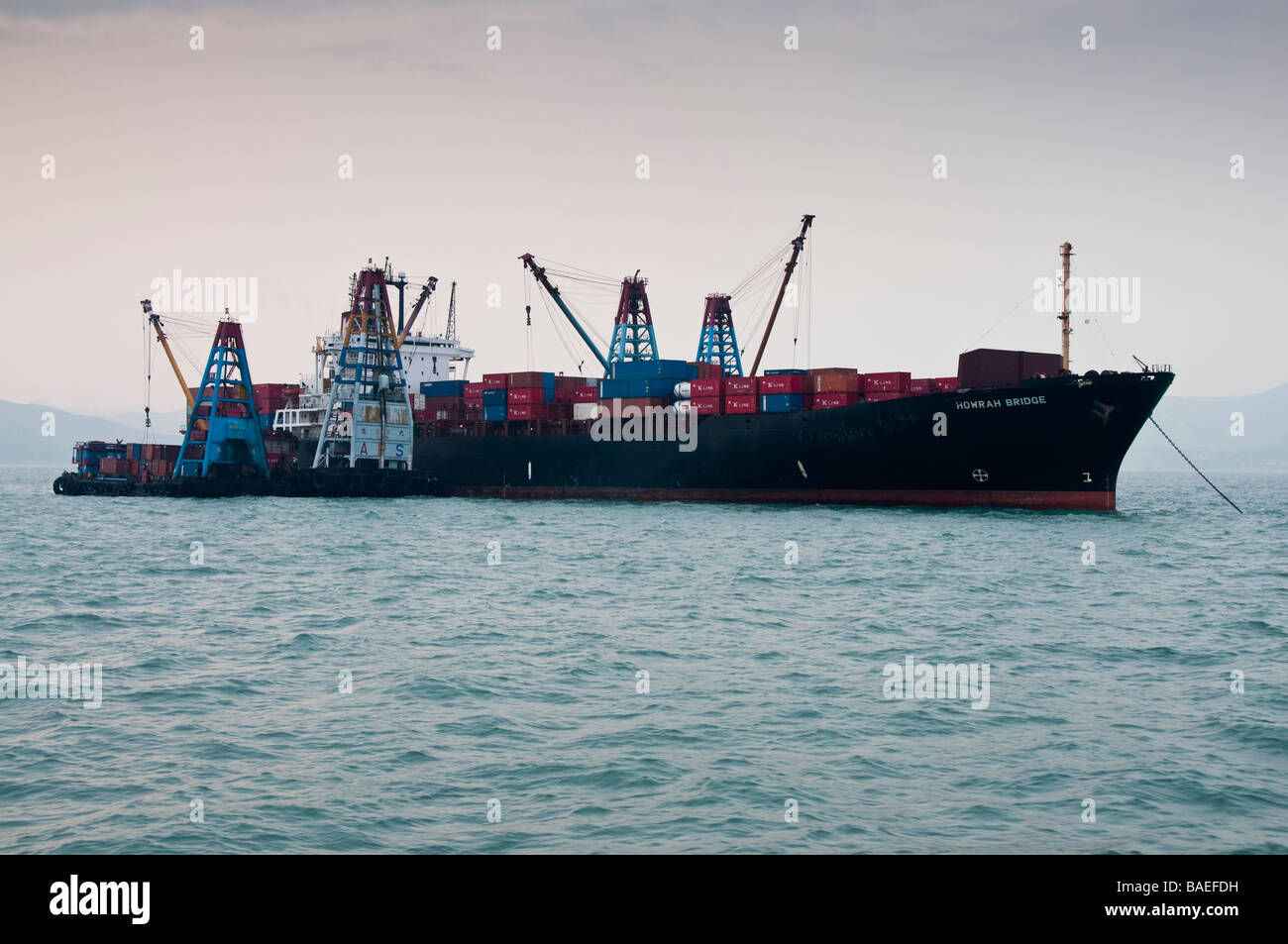 Container ship offloading. - Stock Image