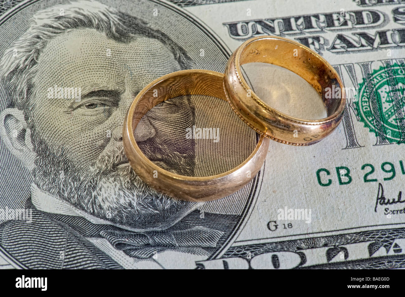 two wedding bands on $50.00 bill - Stock Image
