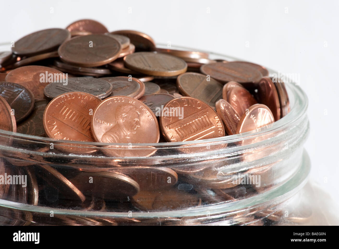 glass jar with pennies - Stock Image