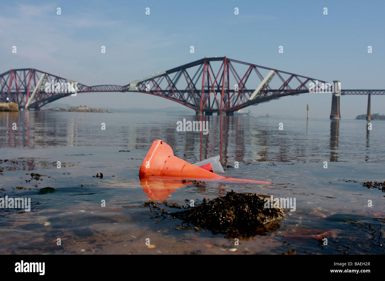 Forth Rail bridge traffic cone in river, pollution river - Stock Image