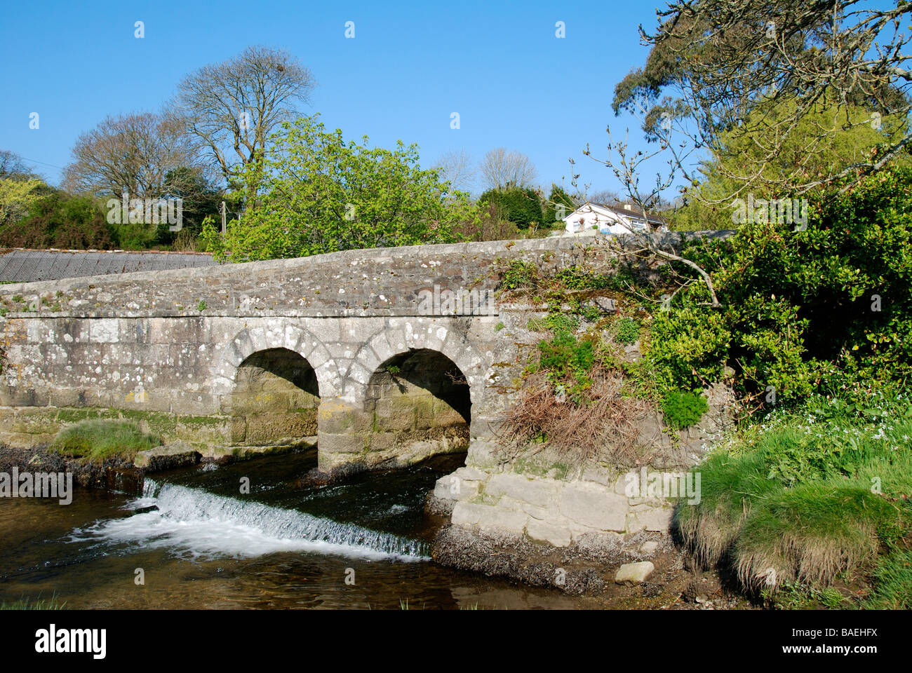 the old granite bridge at gweek near helston in cornwall,uk - Stock Image