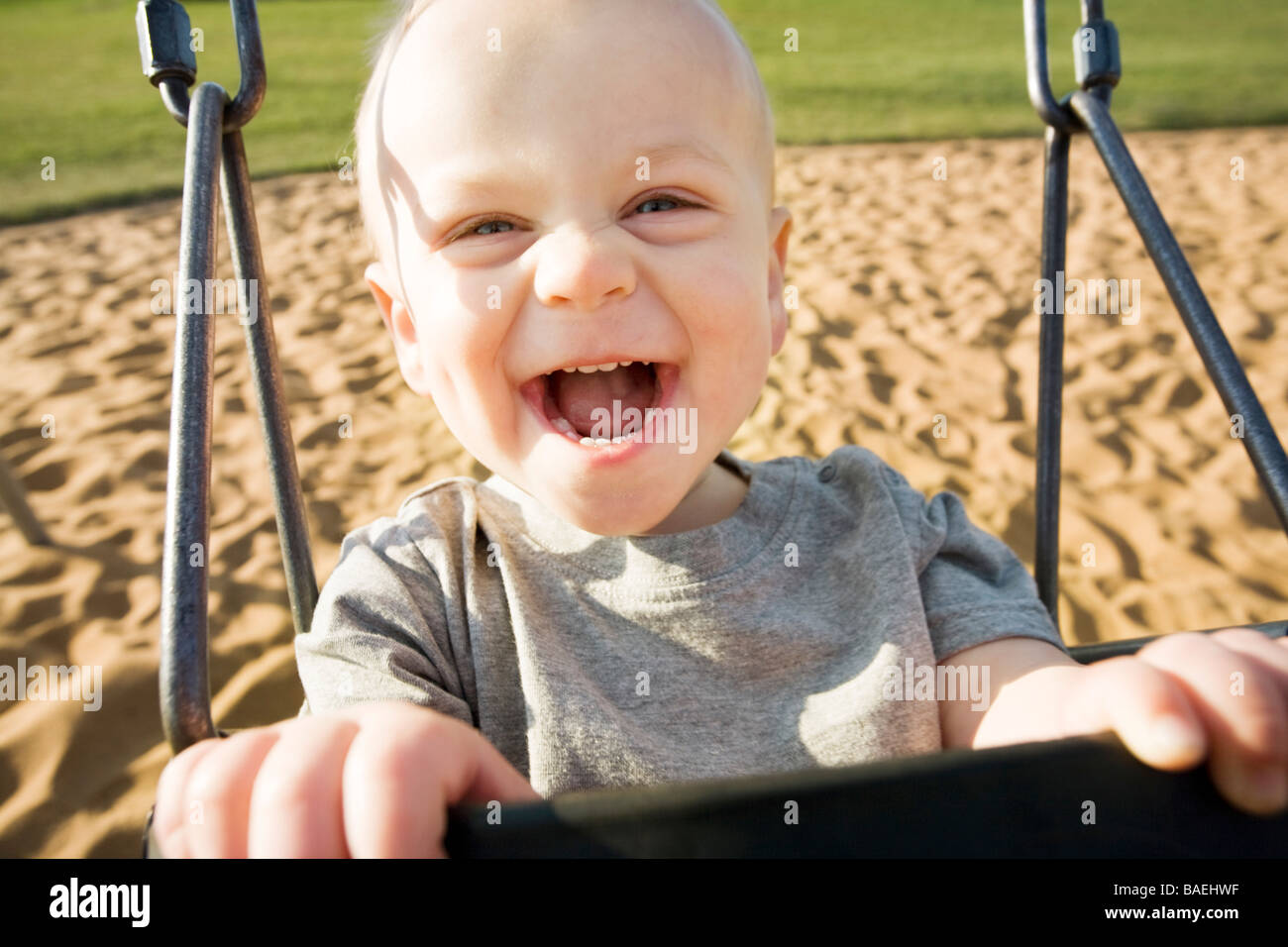 Boy in a swing - Stock Image