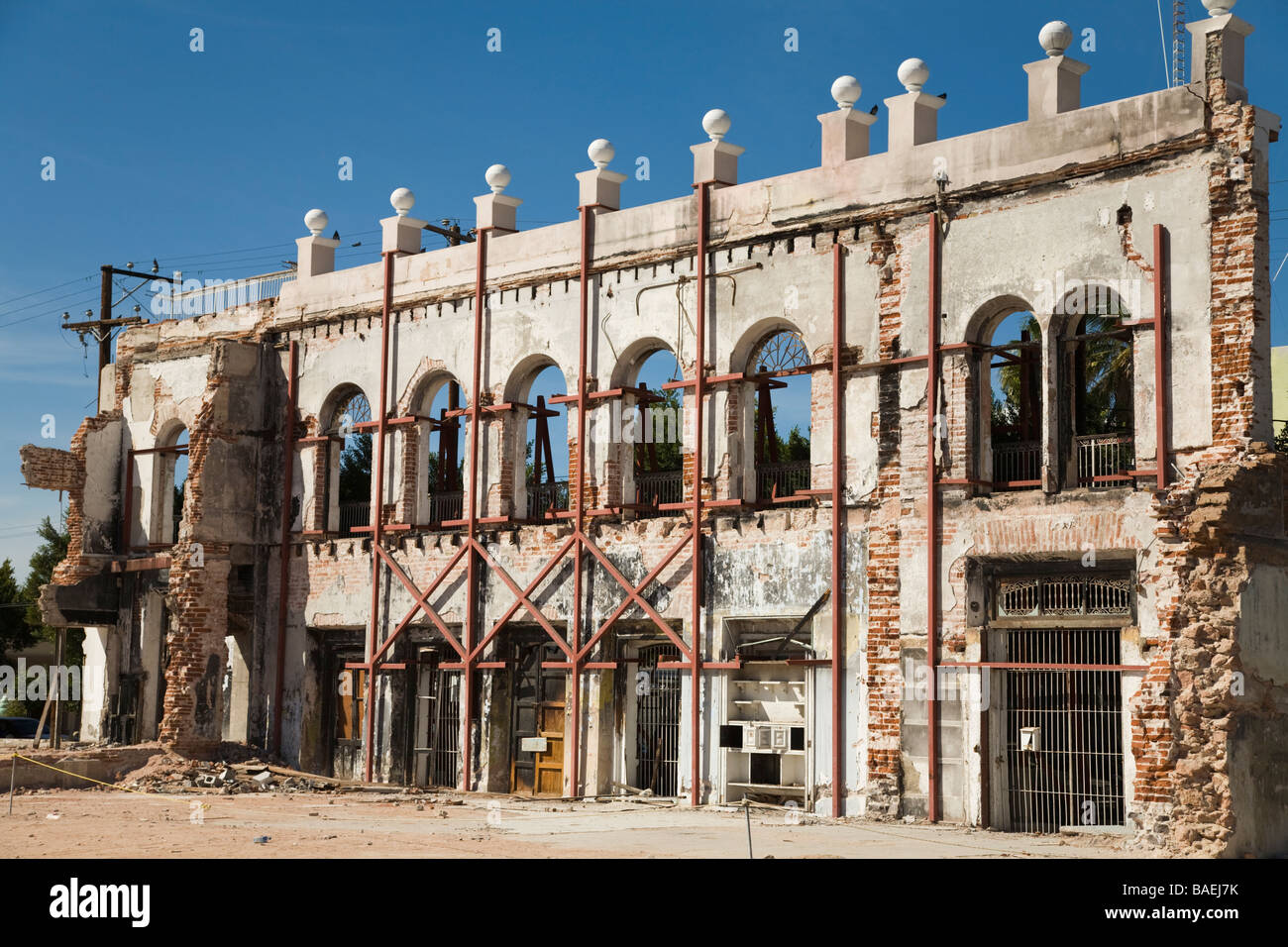 MEXICO La Paz Brick facade of building supported after remainder of structure demolished held in place and supported - Stock Image