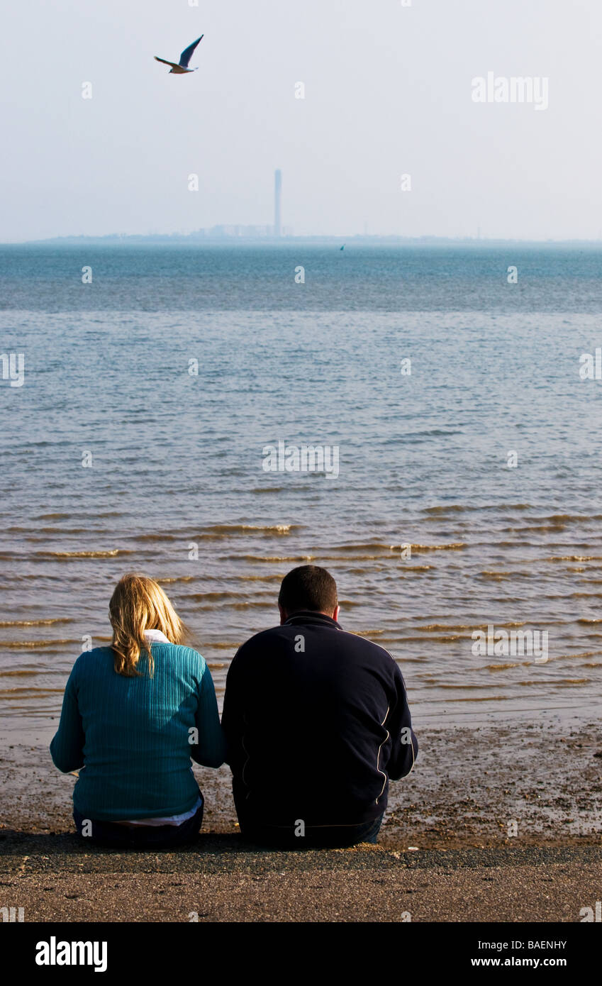 Two people sitting on the promenade at Southend on Sea in Essex.  Photo by Gordon Scammell - Stock Image