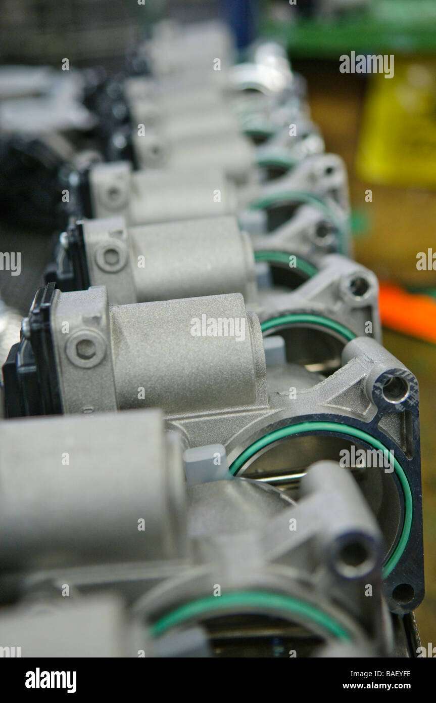 Manufactured car parts on a production line - Stock Image