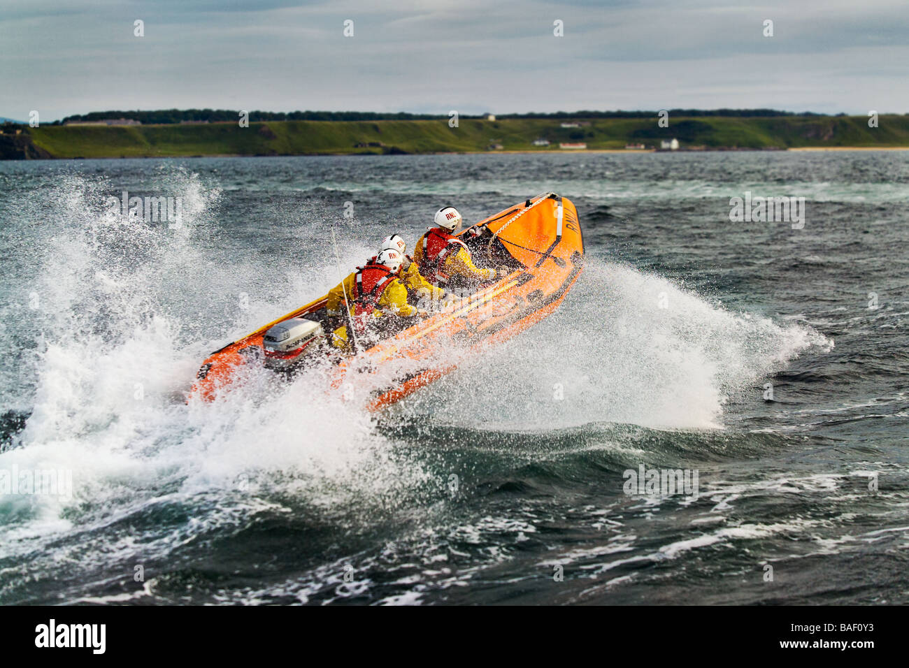 photograph of RNLI rescue rib jumping a wave - Stock Image