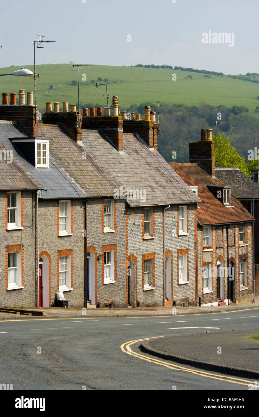 row of Terraced Houses housing Cottages Lewes East Sussex With The South Downs In The Background - Stock Image