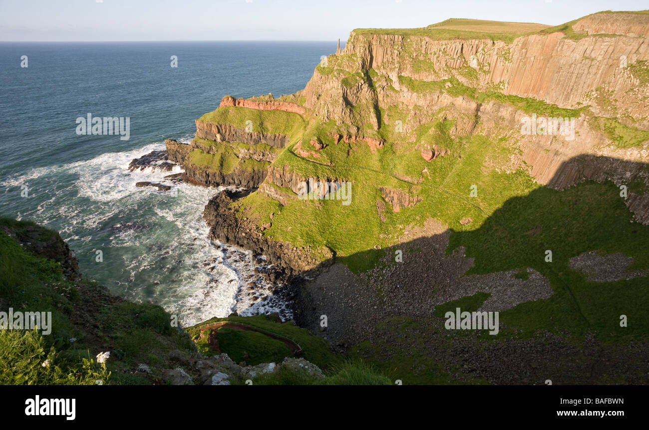 Giant's Cove. A small wave swept cove below the red basalt columns that form the Giant's Causeway. - Stock Image