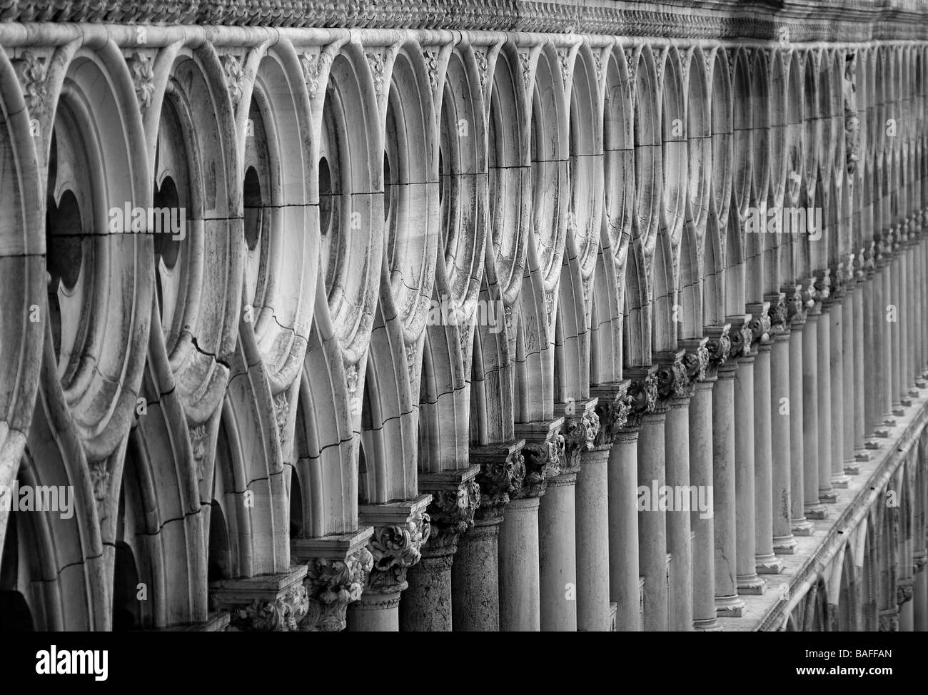 Venetian decorative columns and windows receeding into the distance with small depth-of-field. Venice Italy - Stock Image