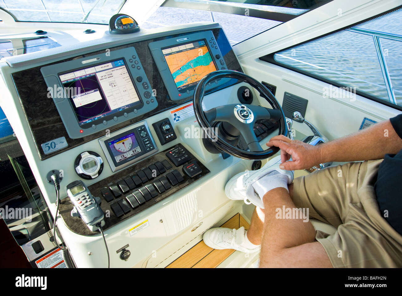 Helm of Sea Ray 43 powerboat with radar, chart plotter and navigation instruments - Stock Image