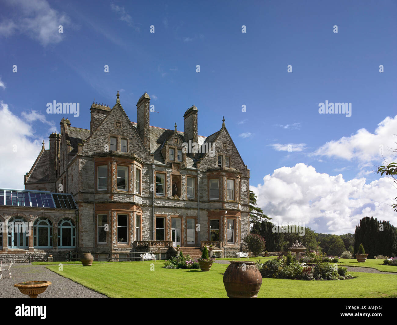 Exterior view of the Club Pavilion from the gardens at Castle Leslie Estate - Stock Image