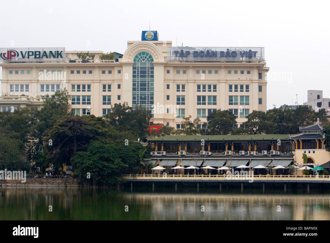 Buildings along Hoan Kiem Lake in Hanoi Vietnam - Stock Image