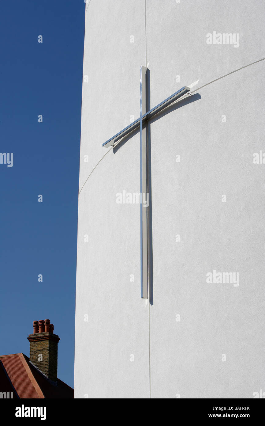 St Andrews Church, London, United Kingdom, Squire and Partners, St andrews church detail of cross and chimney pots. - Stock Image
