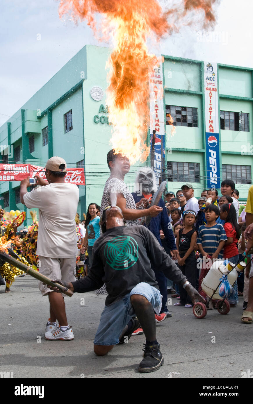 Fire-breather in the street at the Ati-Atihan festival in Kalibo, Philippines - Stock Image