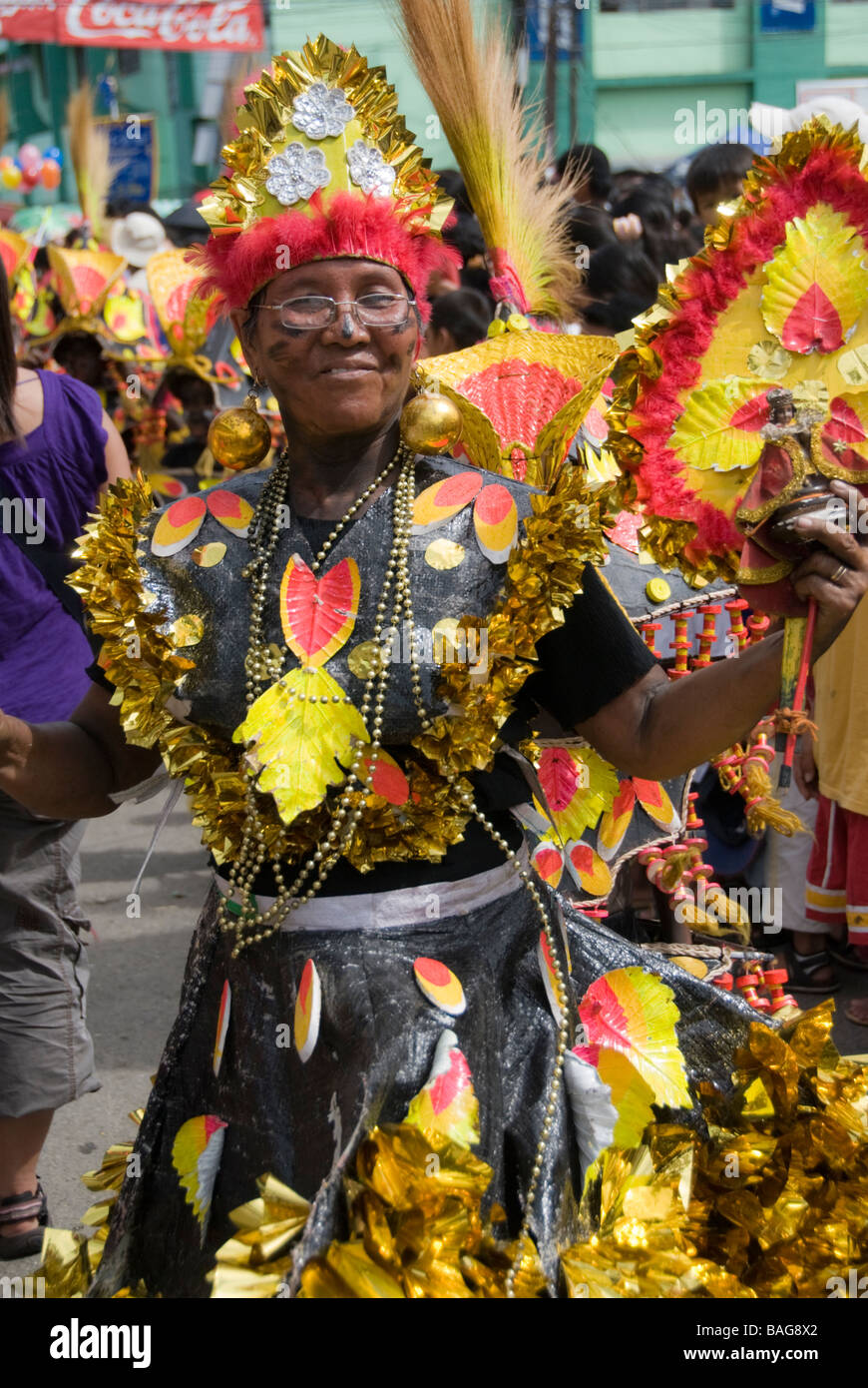 Reveller in costume at the Ati-Atihan festival in Kalibo, Philippines - Stock Image
