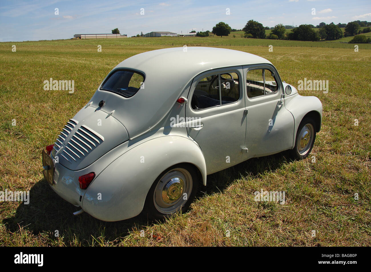 a well restored 1961 renault 4cv modele affair in a field