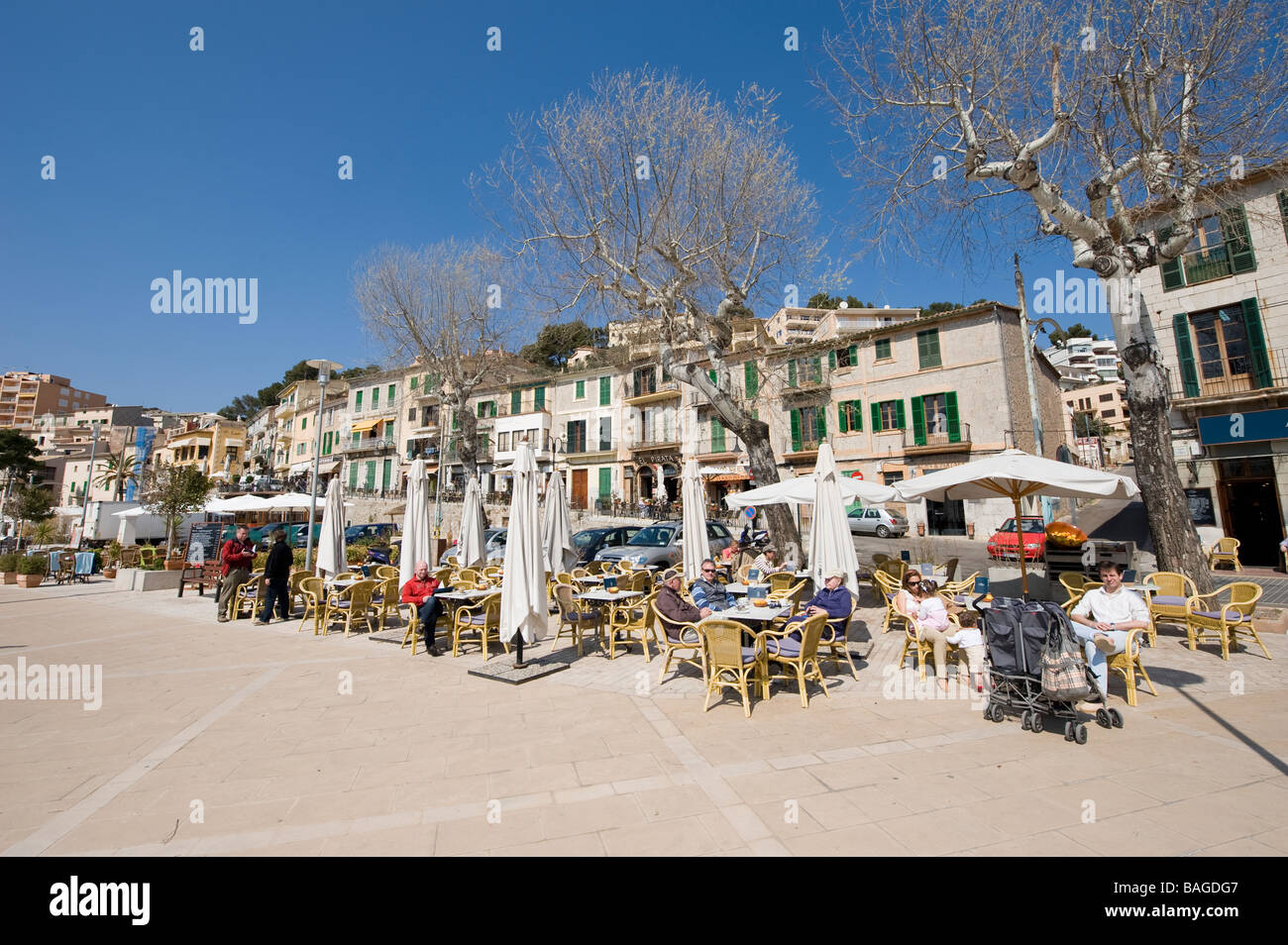 People sitting and eating al fresco in the spanish resort of Stoller Mallorca Spain - Stock Image