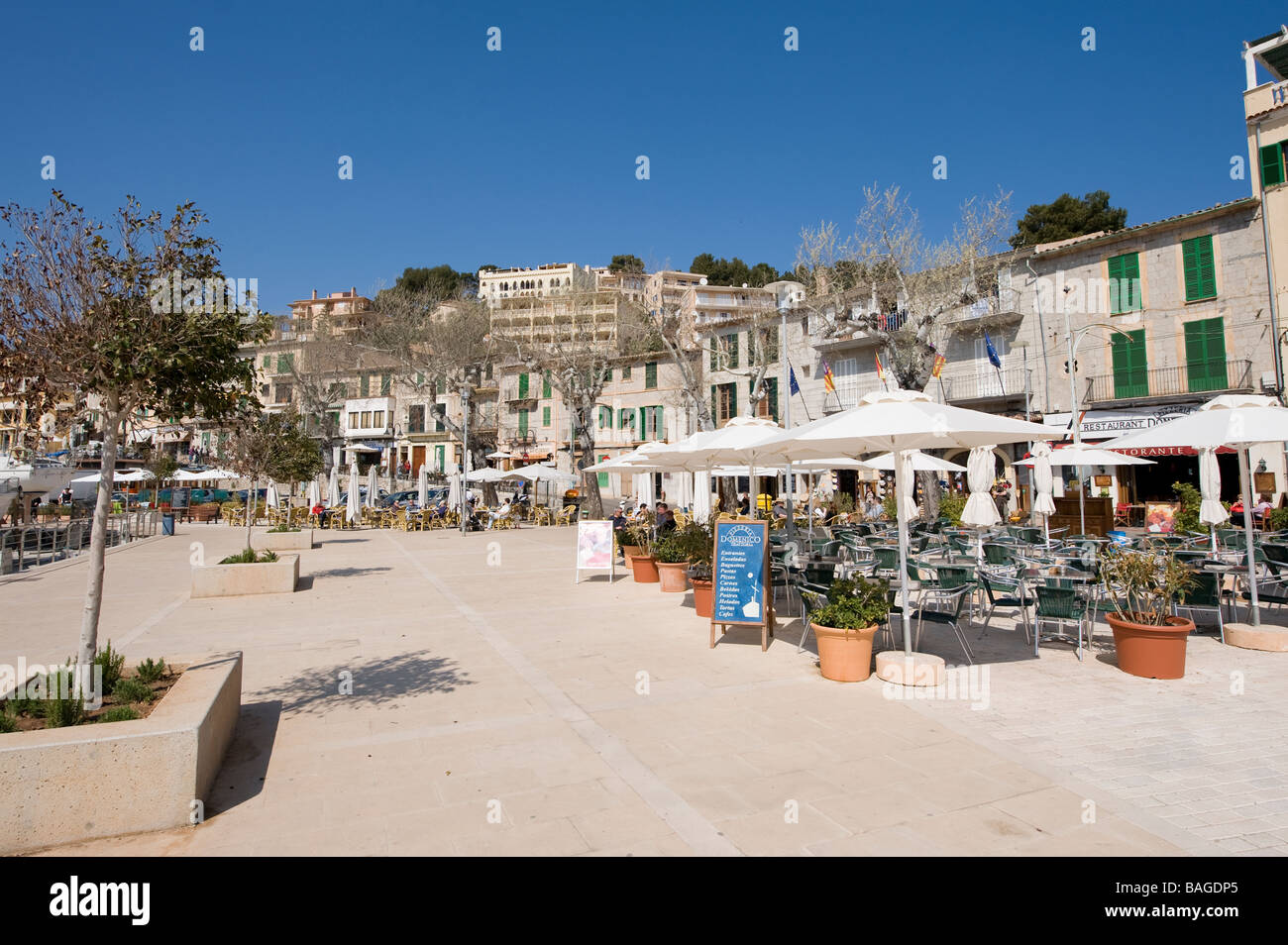 Tables and chairs outside bars cafes and restaurants in the spanish resort of Stoller Mallorca Spain - Stock Image
