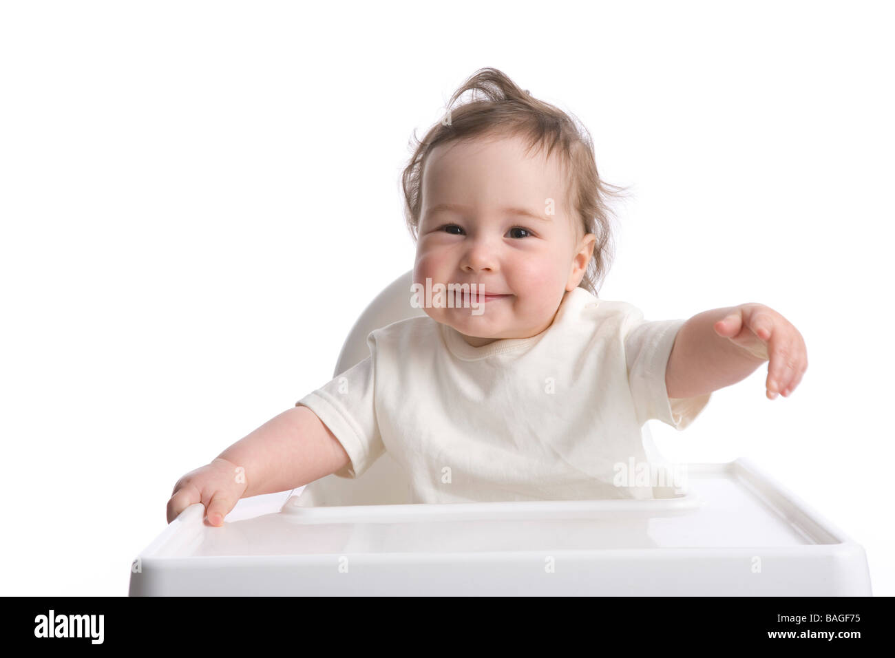 Toddler girl in a bay-chair - Stock Image