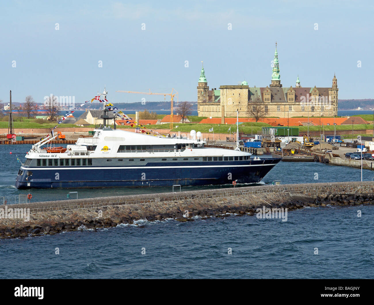 Fast passenger vessel Siluna ACE leaving Helsingor harbour in Denmark en route to Helsingborg in Sweden - Stock Image