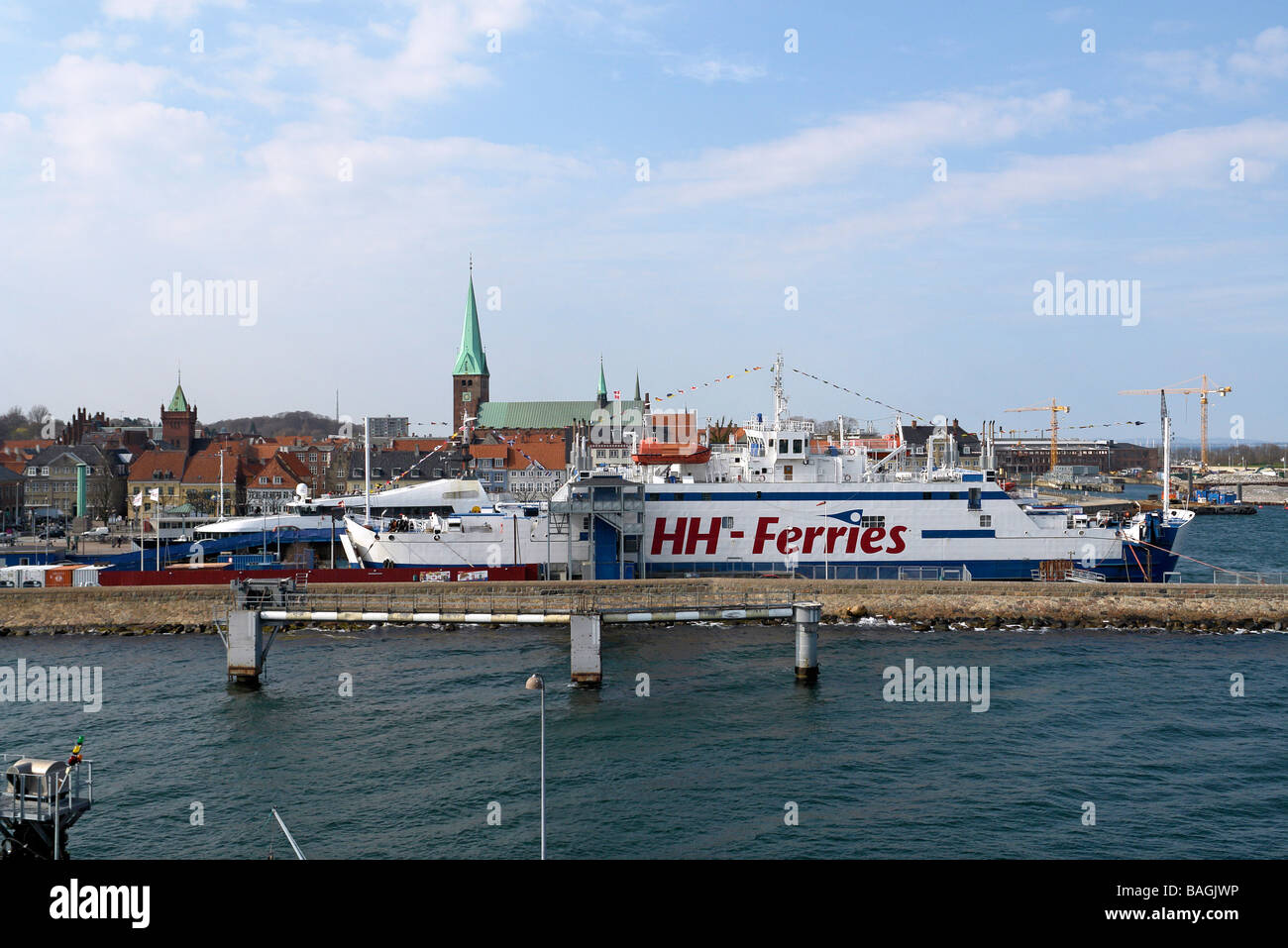 The harbour in Elsinore with one of HH ferries' Superflex ferries berthed - Stock Image