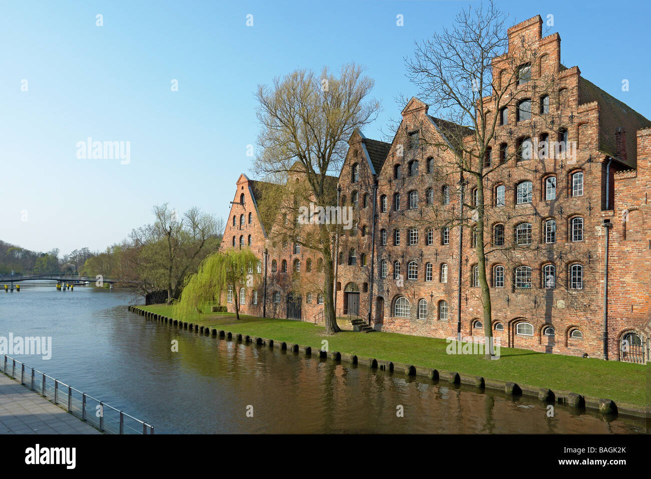 Salt store houses in Lubeck Germany located adjacent viewed from bridge over Trave - Stock Image