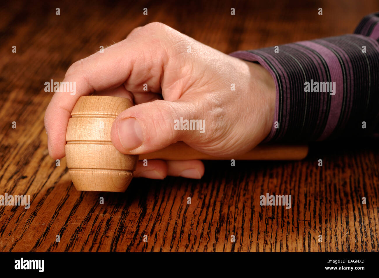 Auctioneer hand and hammer - Stock Image