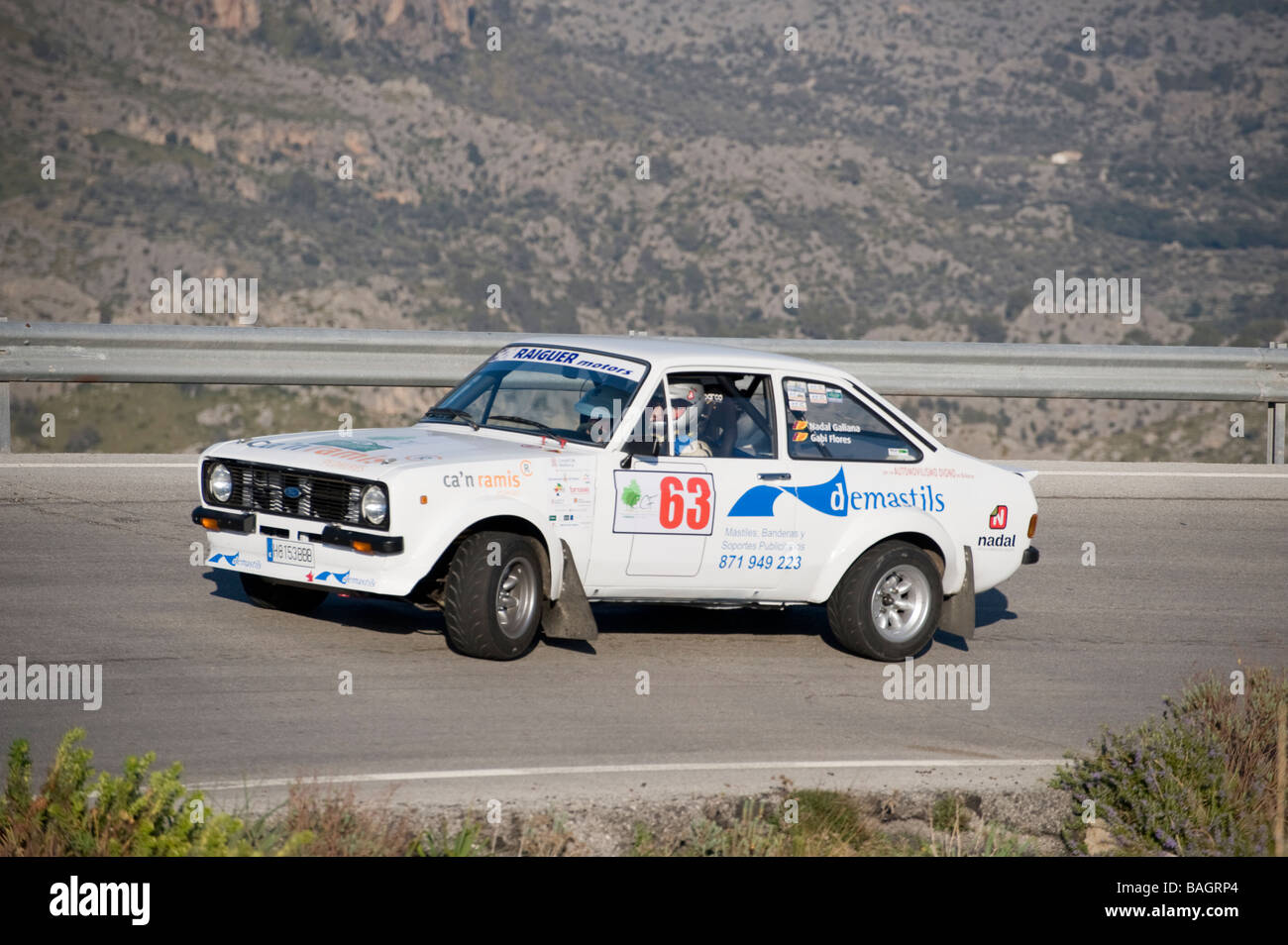 Side view of a white 1975 Ford Escort classic sports car racing in the Classic car rally Mallorca - Stock Image