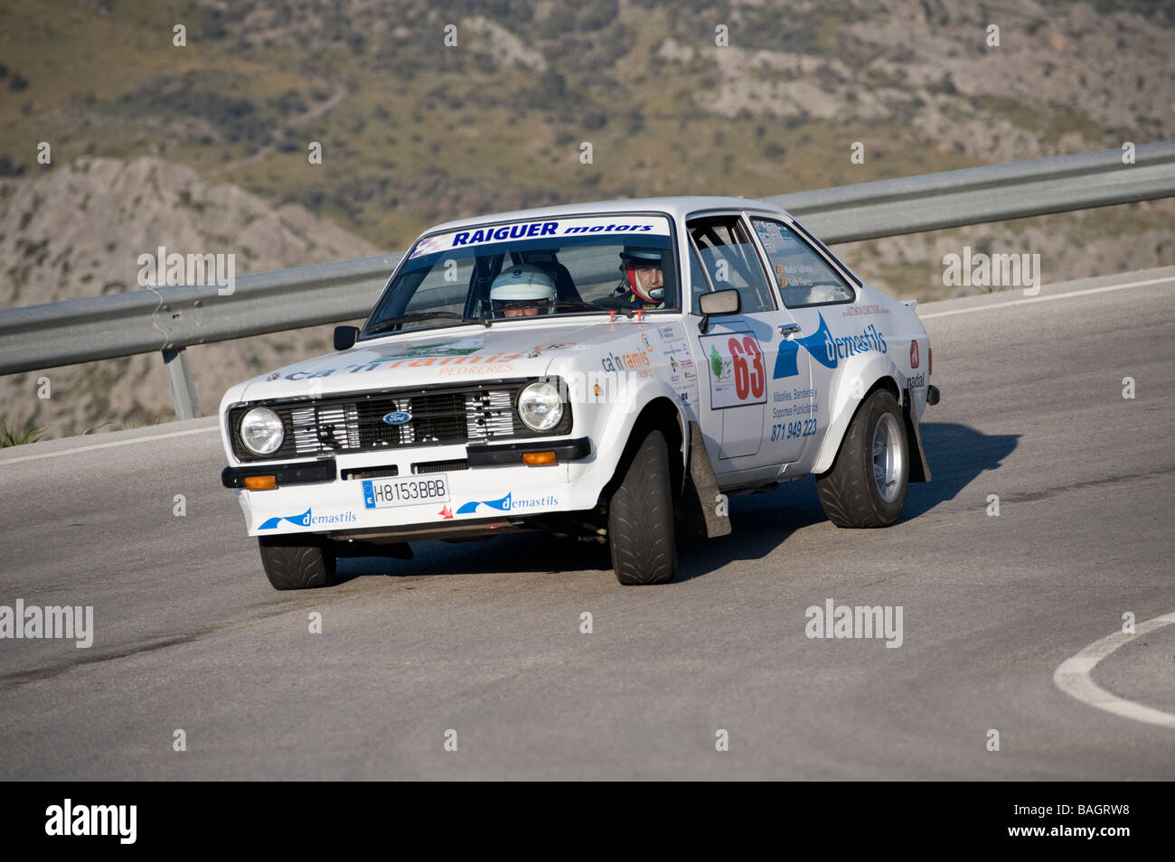 White 1975 Ford Escort classic sports car racing in the Classic car rally Mallorca - Stock Image