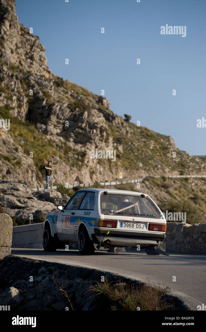 Rear view of a white 1975 Ford Escort classic sports car racing in the classic car rally Mallorca - Stock Image