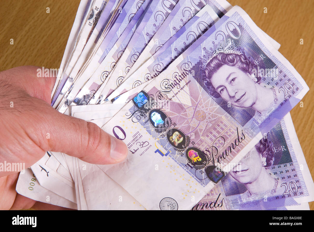 Hand holding British Money - Stock Image