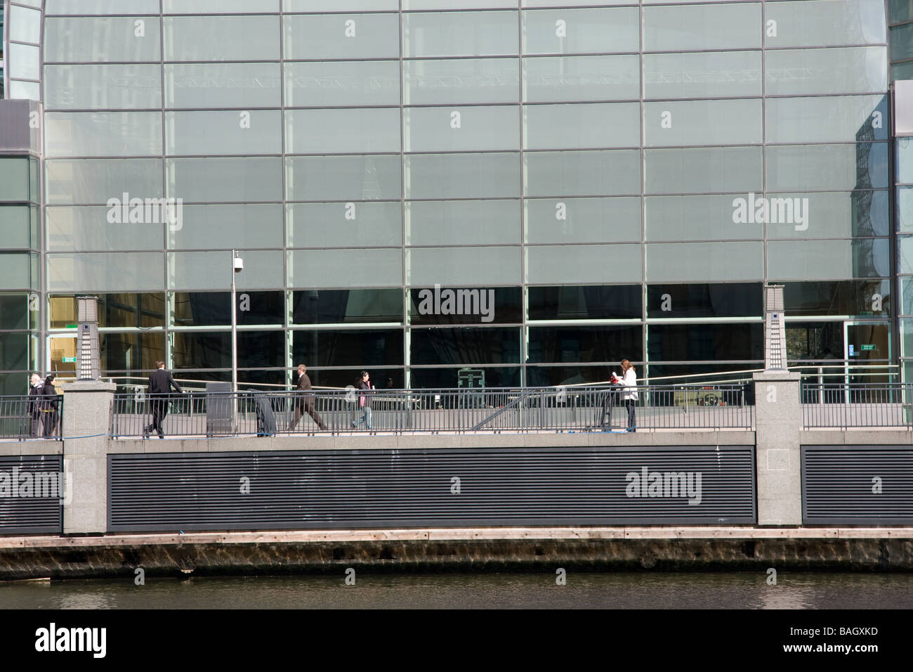 bankers outside office smoking relaxing canopy hot Heron Quay Docklands Isle of Dogs London - Stock Image