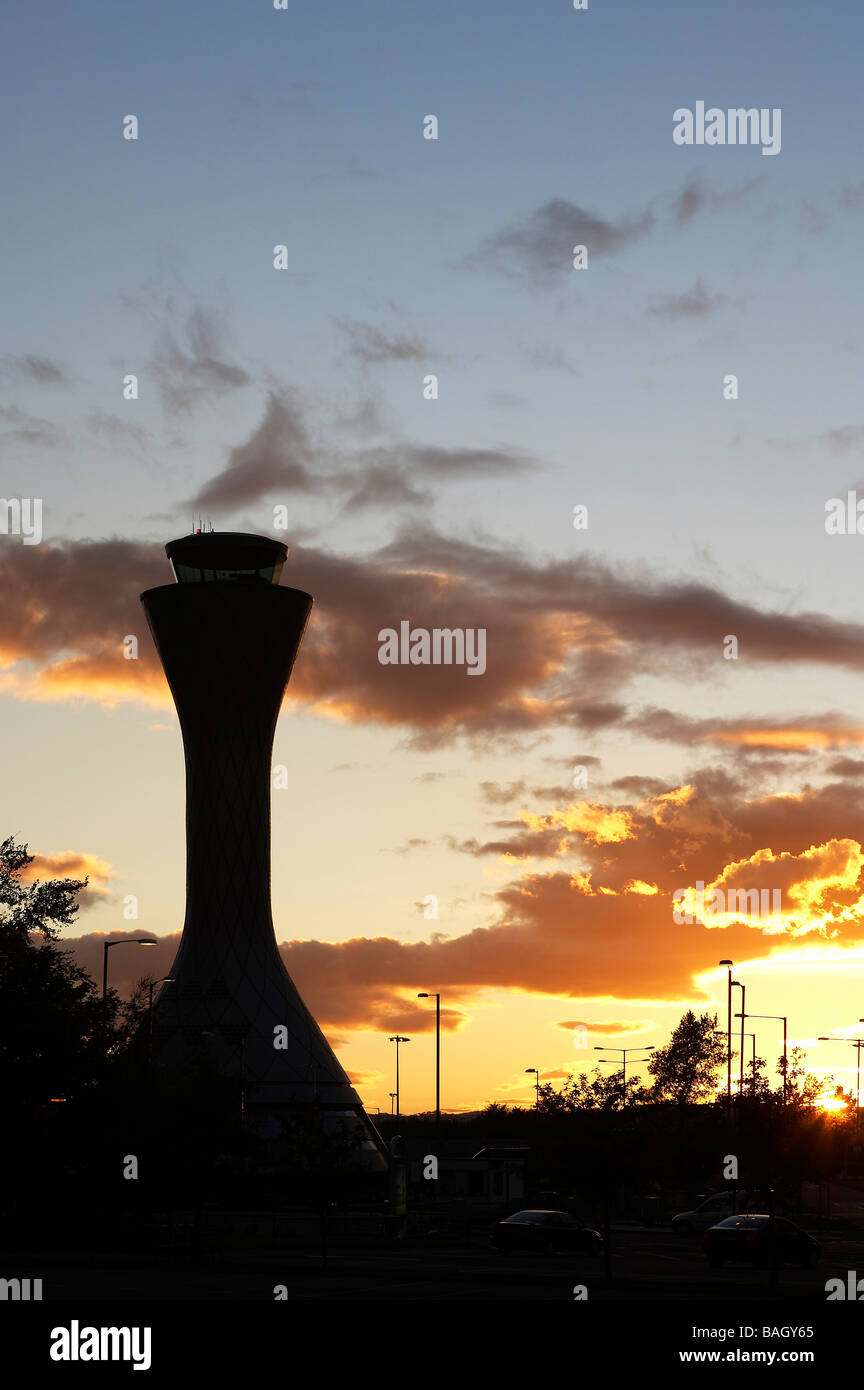 air traffic control tower sillouette of tower with orange sunset - Stock Image