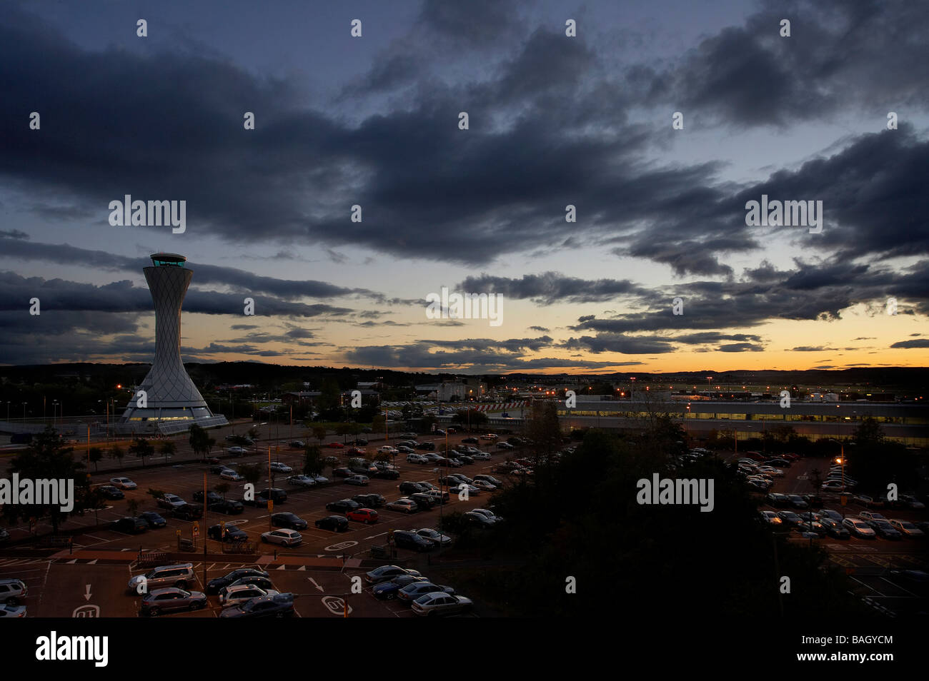 air traffic control tower sunset view with moving clouds across car parks Stock Photo