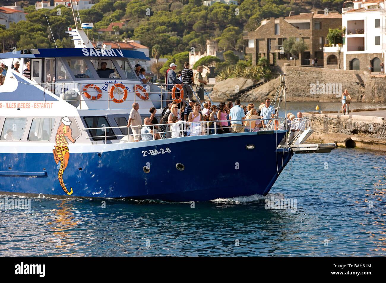 Spain, Catalonia, Costa Brava, Cadaques, boat linking the sea port Stock Photo