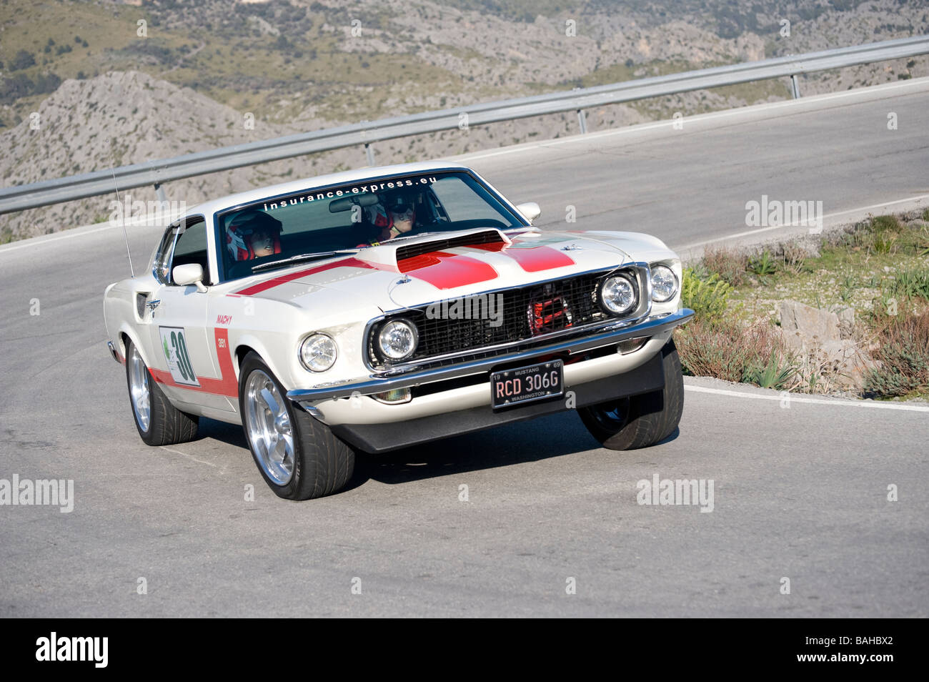 1969 White Ford Mustang classic sports car racing in the Mallorca classic car rally - Stock Image