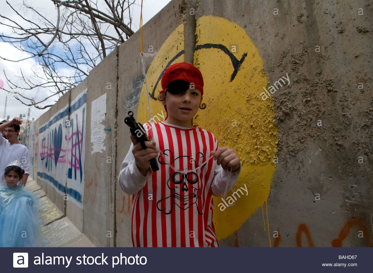 Right wing Jewish settlers marking the Jewish holiday of Purim in the divided West Bank town of Hebron Israel - Stock Image
