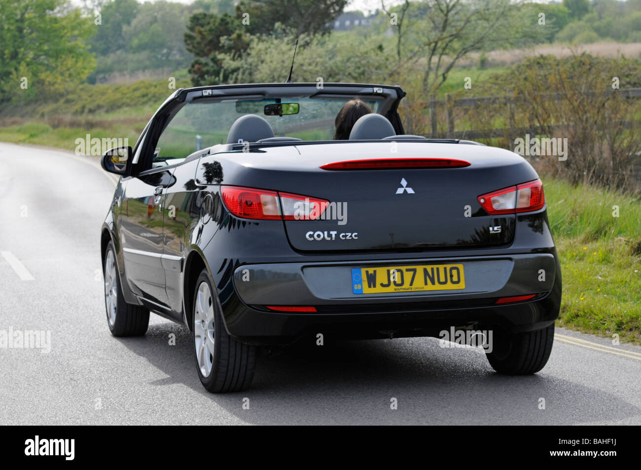 2007 Mitsubishi Colt CZC Cabriolet being driven along road by young