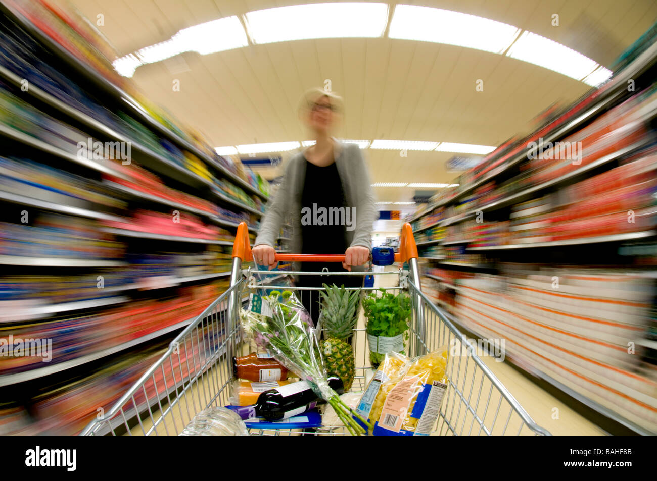 Women Pushing Trolley, Supermarket Shopping, UK - Stock Image