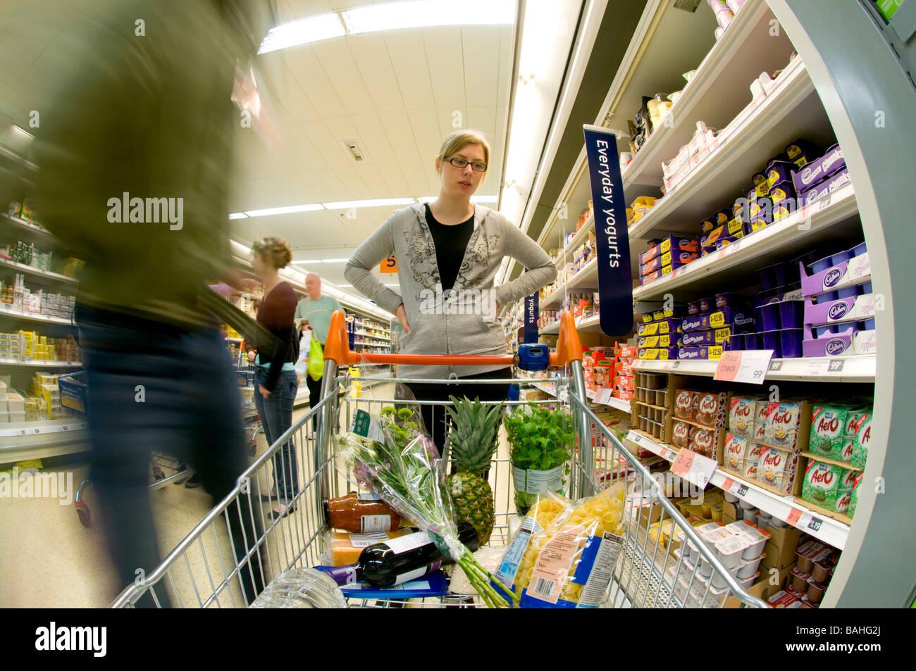 Couple Supermarket Shopping, UK - Stock Image