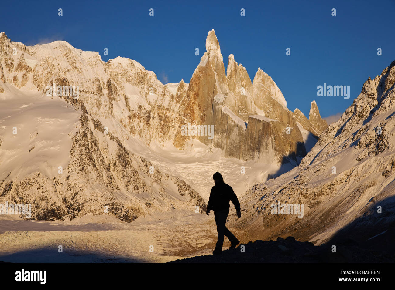 Silhouette of tourist Sunrise on the Cerro Torre massif Glacier Glaciares National Park Andes Santa Cruz Province - Stock Image