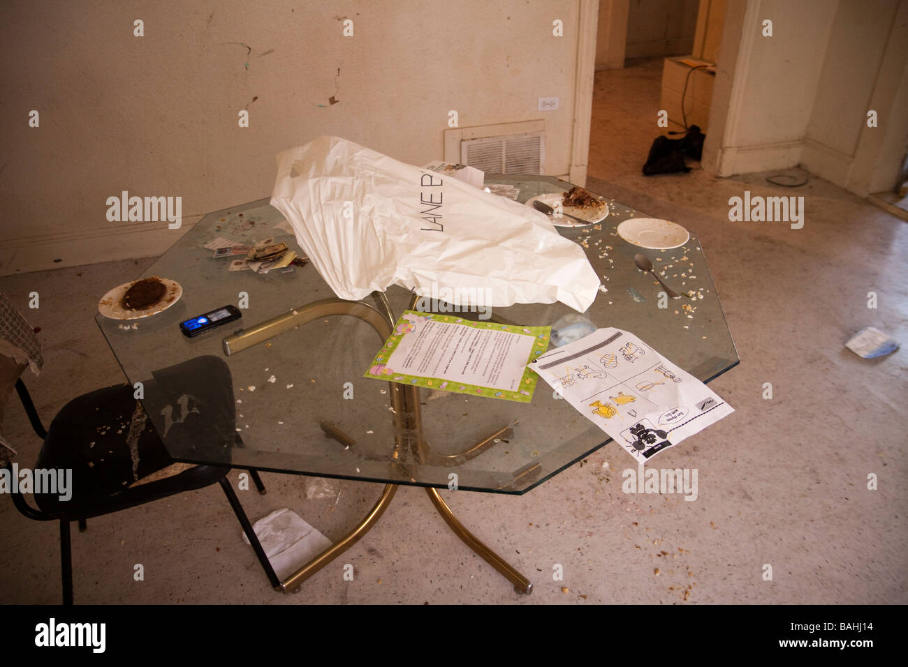 Filthy table in drug dealer's home. People living here was using and selling heroin. - Stock Image