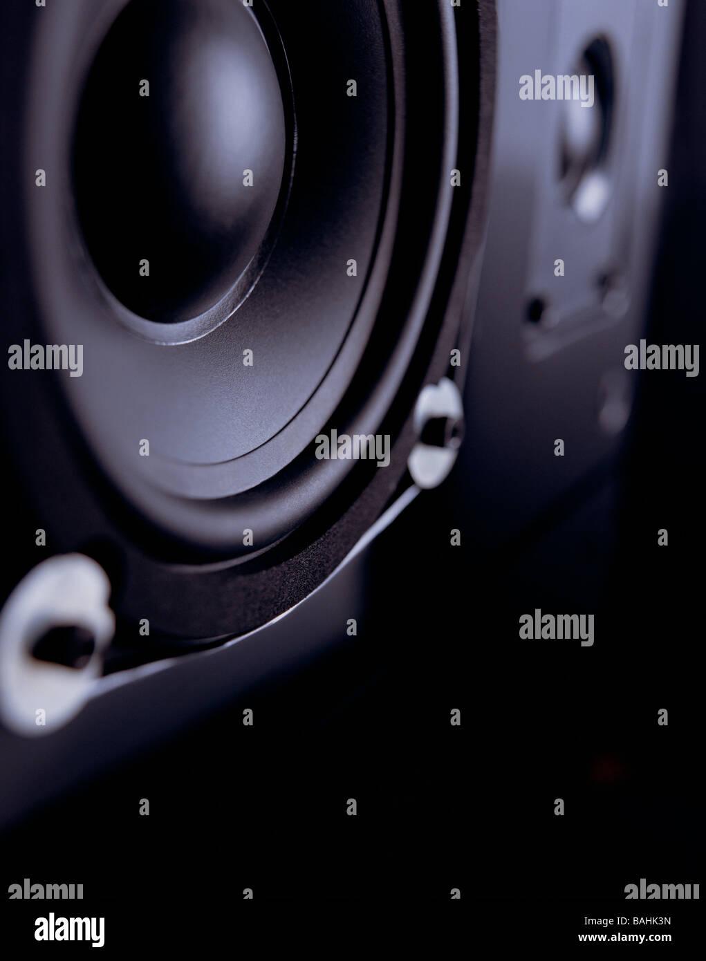 Black Bass Speaker on Black Lacquered Table - Stock Image