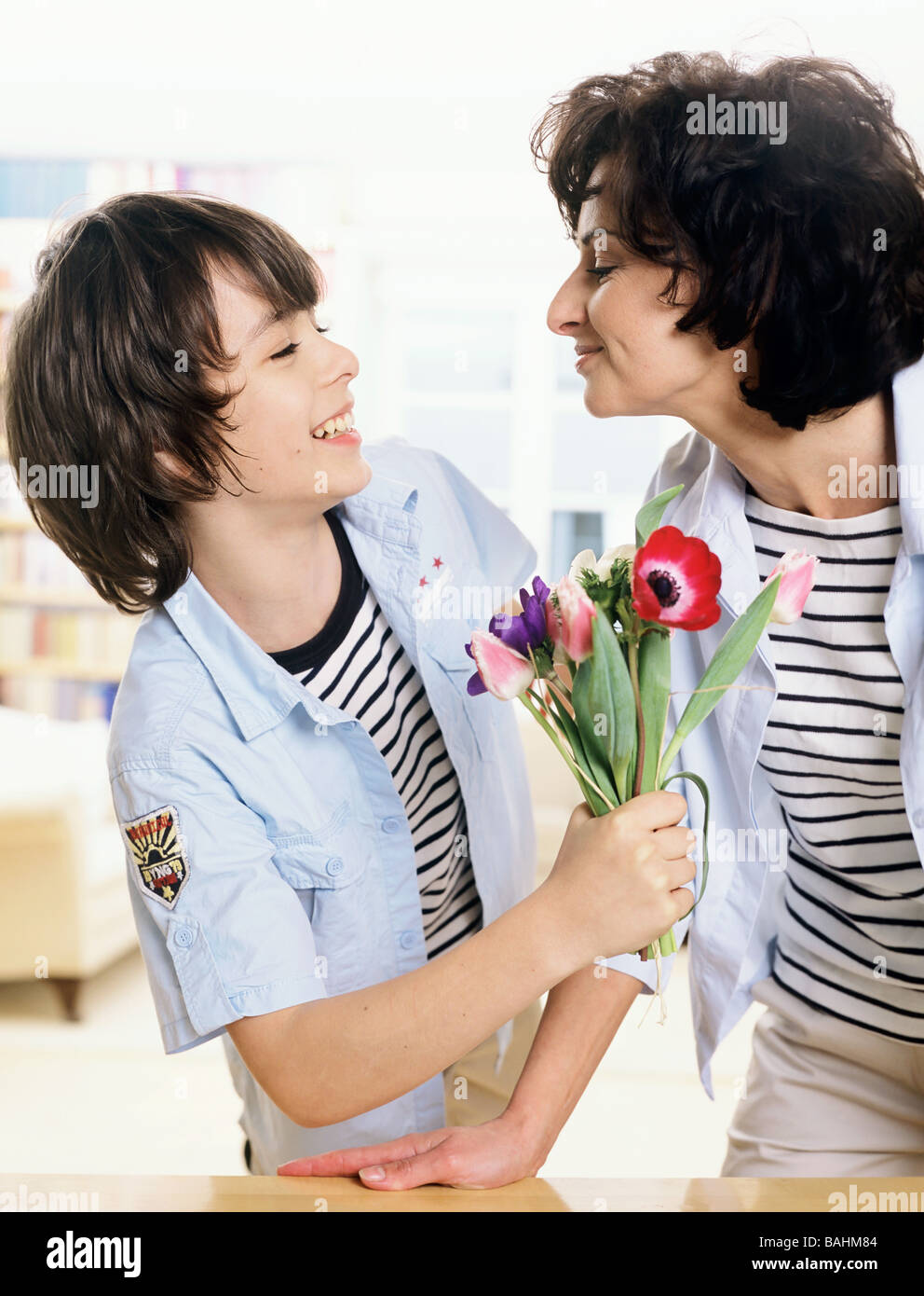 people, boy, teenager, 10-15, 15-20, son, dark, haired, woman, 40-45, 45-50, mother, smile, smiling, same, similar, - Stock Image