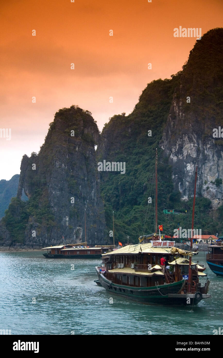 Scenic views of limestone karsts and tourist boats in Ha Long Bay Vietnam - Stock Image