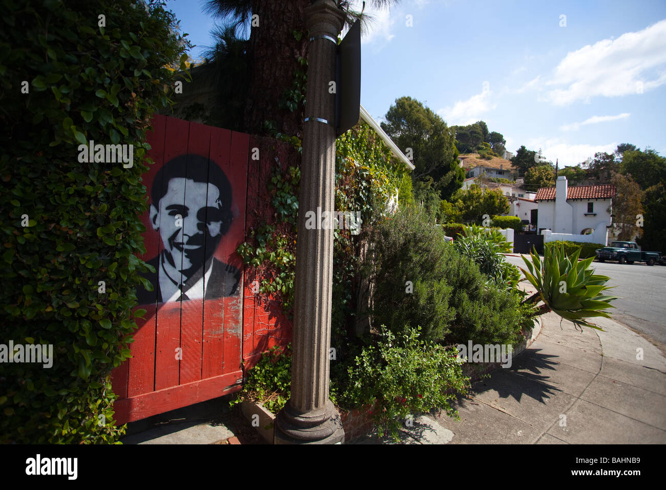 Stencil graffiti of Barack Obama on the gate of a garden, Hollywood, California, USA - Stock Image