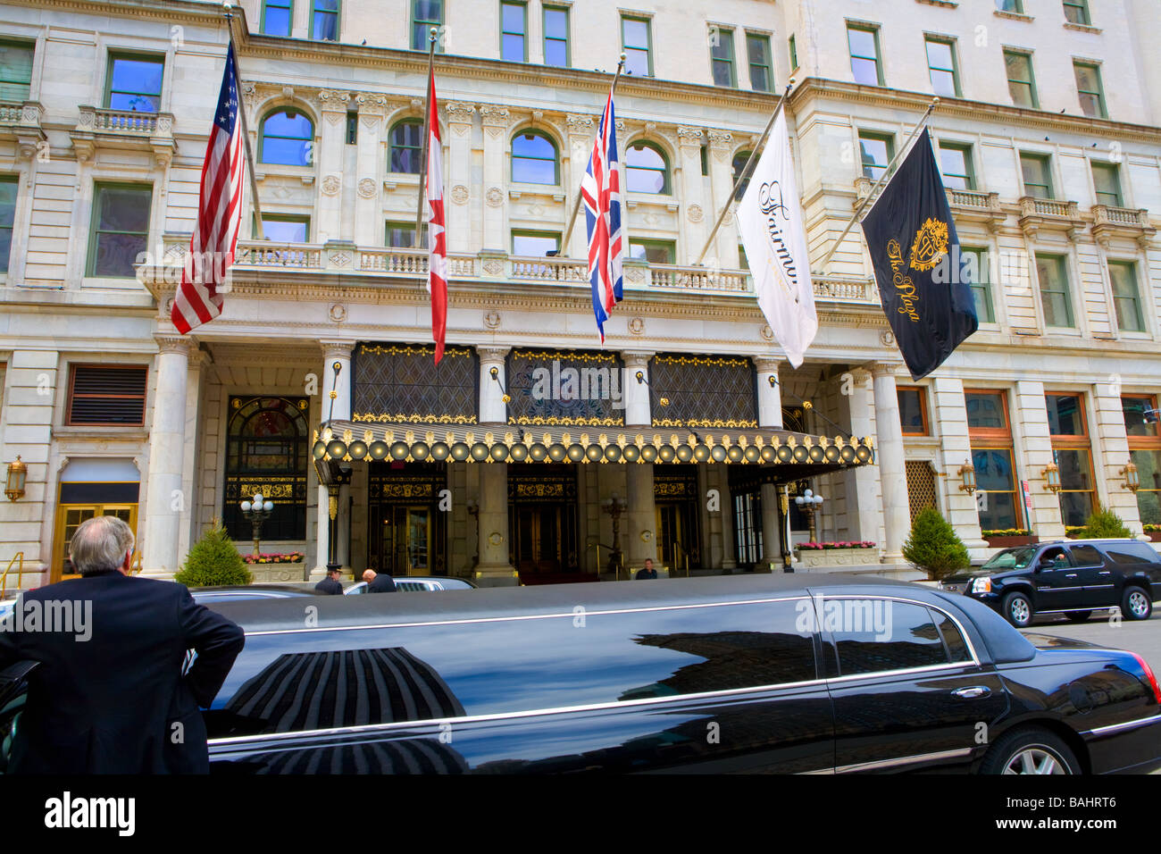 Limousines line up at The Plaza Hotel across from Central Park New York City - Stock Image